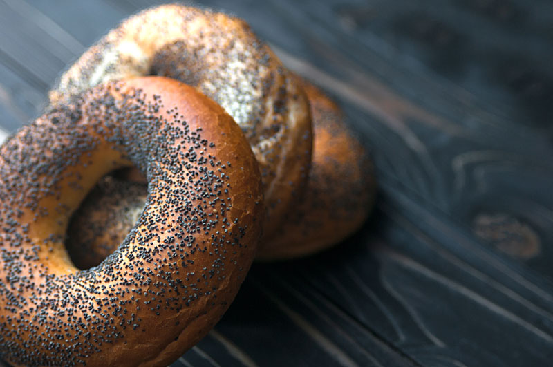 A pile of poppy seed bagels