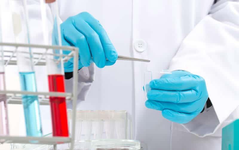 Scientist testing a liquid in a laboratory