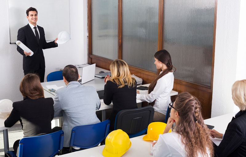 employees in a meeting to discuss workplace drug testing
