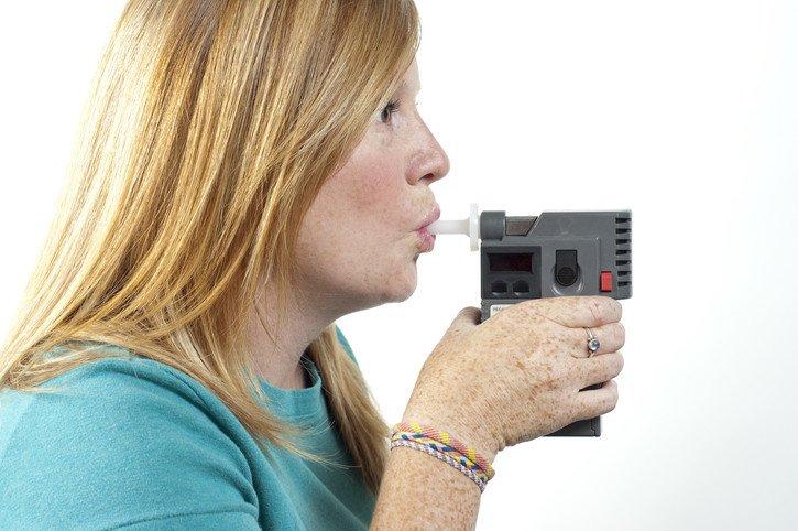 Woman taking an Alcohol EBT