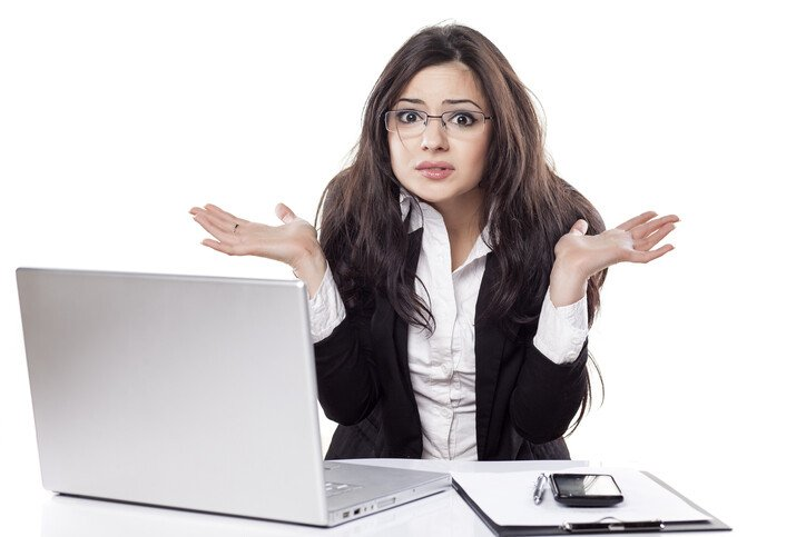 Stressed confused business woman at computer