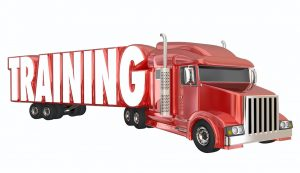 a red semi that says training